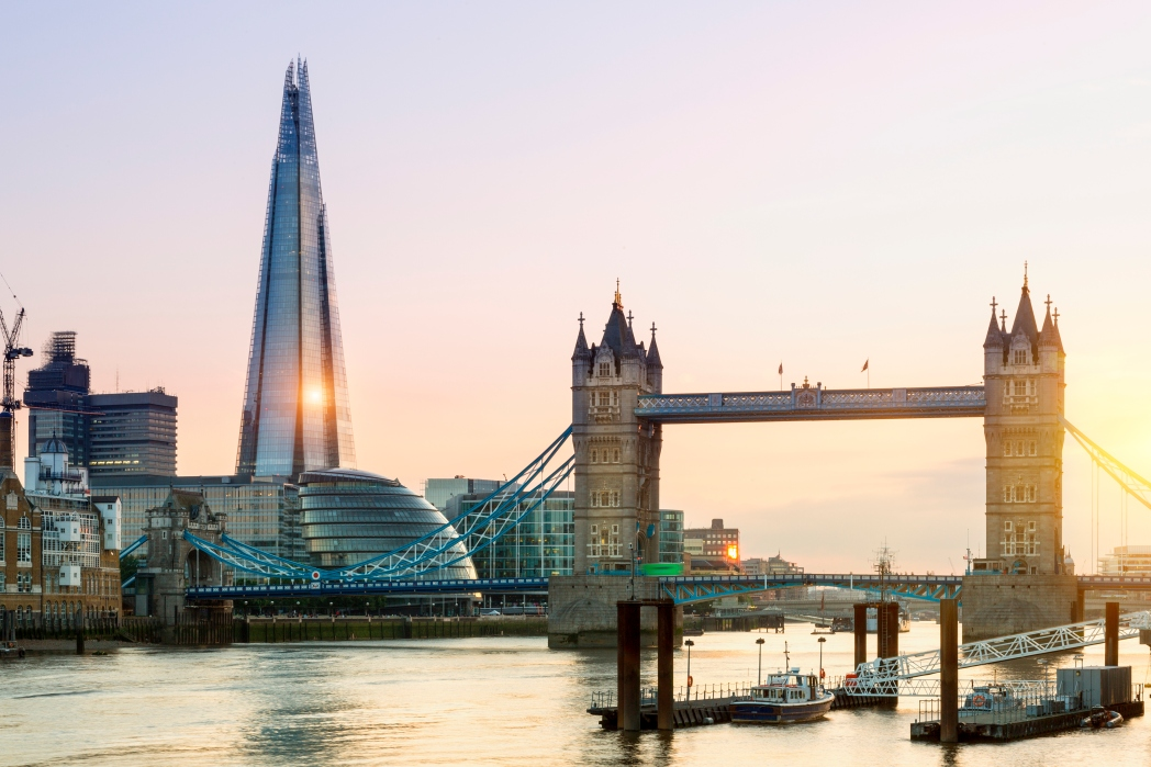 A sunset view of Tower Bridge and City Hall